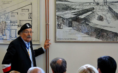 "Survivor Samuel Willenberg presenting his drawings of Treblinka II in the Museum of Struggle and Martyrdom at the site of the camp. On the right, the ""Lazaret"" killing station."