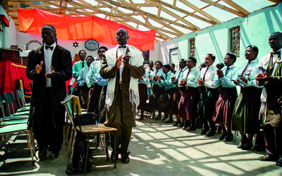 Every Shabbat morning, more than 100 members of the Shona Jewish community outside Rusape, Zimbabwe, gather at their tabernacle for services, wearing their best clothes, and sing original African-Jewish melodies in Hebrew, Shona, and English, resembling American gospel music (c) Jay Sand 1999
