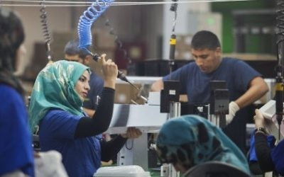 Employees work at a SodaStream factory built deep in Israel's Negev Desert next to the city of Rahat, Israel