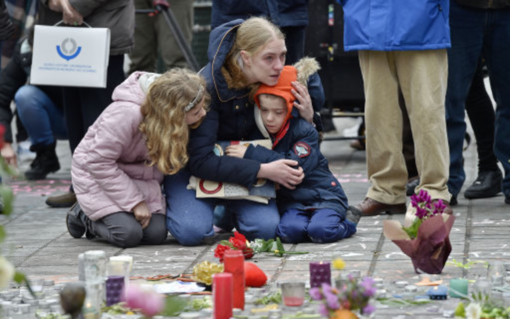 People pay their respects to those who were murdered