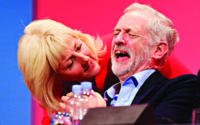 Labour leader Jeremy Corbyn laughs next to delegate Jennie Formby at the party's 2016 conference in Brighton.