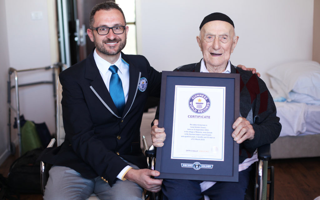 Marco Frigatti, Head of Records for Guinness World Records, presented Israel Kristal his certificate of achievement for Oldest living man on 11th March 2016, Haifa, Israel.   Picture credit: Dvir Rosen/Guinness World Records