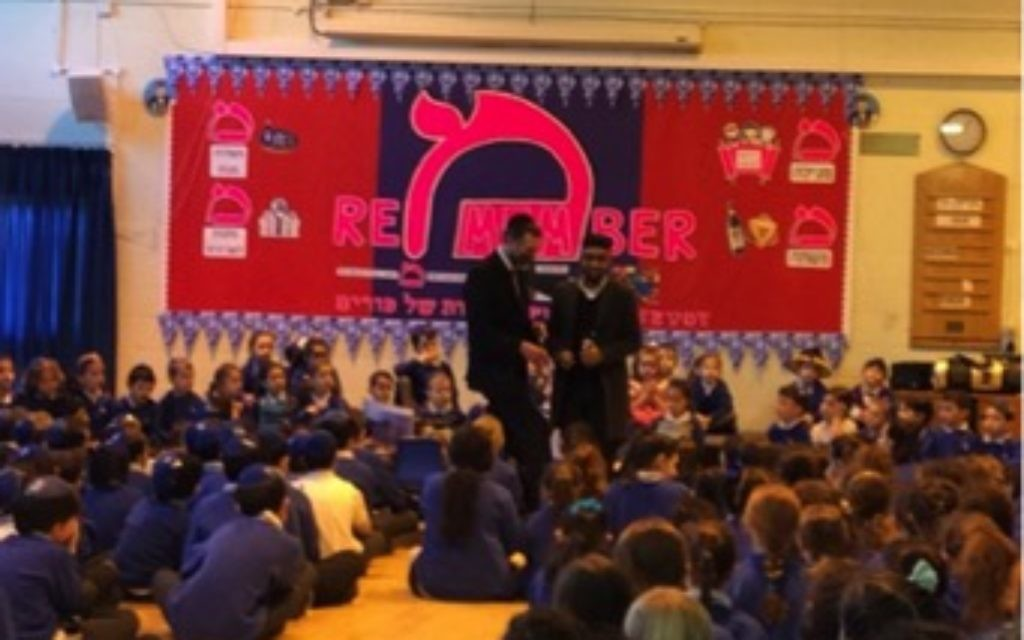 Imam Hasan and Rabbi Lister speaking together at an assembly