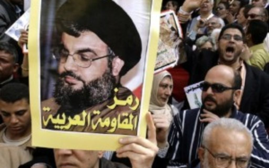 Hezbollah's leader Hassan Nasrallah's portrait is held up at a rally