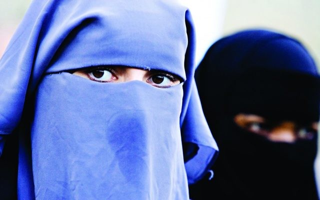 Muslim women wearing a full-face veil