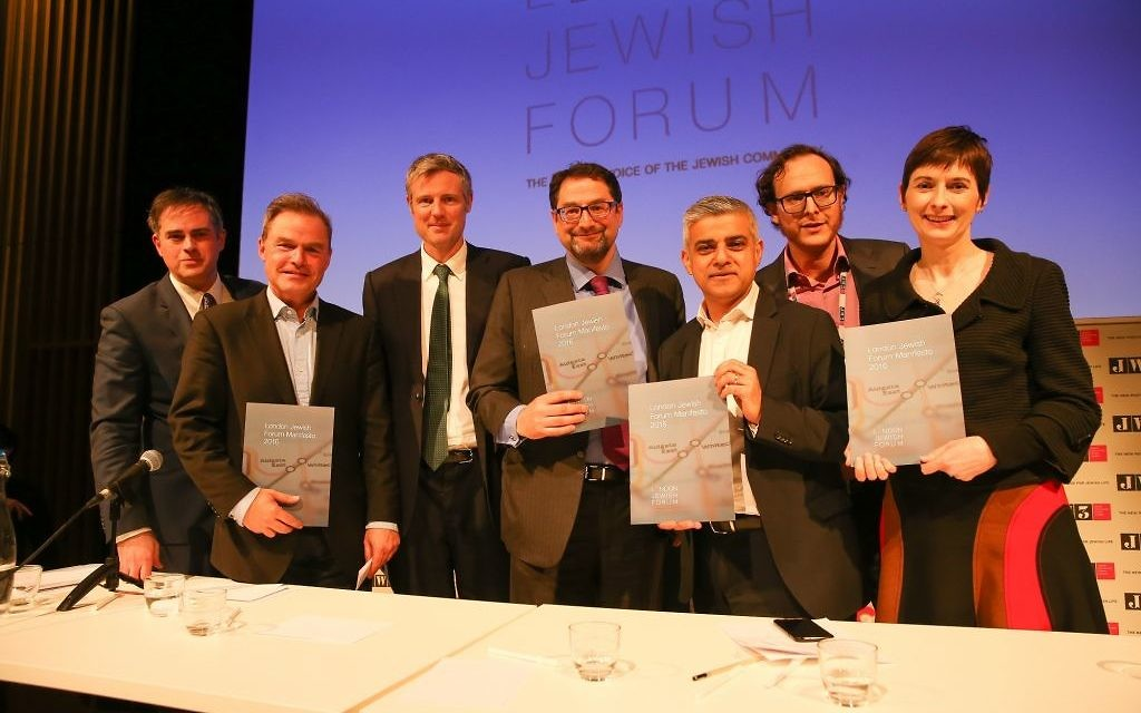 All the candidates at the Jewish News, London Jewish Forum Mayoral hustings with  JW3, holding the LJF's manifesto.