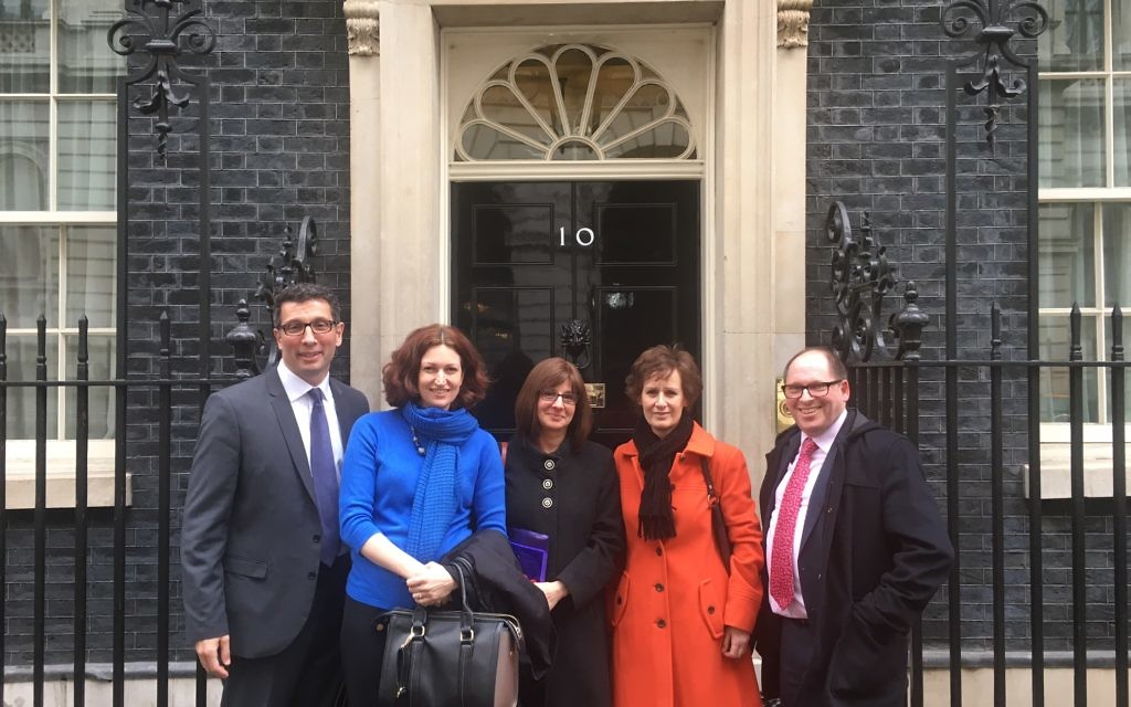 Social care leaders pose outside the iconic entrance to 10 Downing Street before their summit