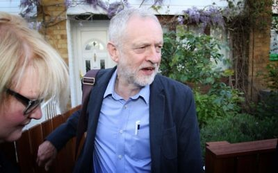 Jeremy Corbyn is greeted by the press on Friday morning after leaving his house.