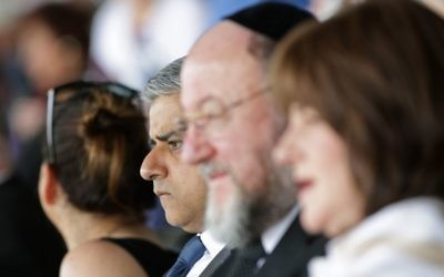 Watching the commemoration in the company of the Chief Rabbi