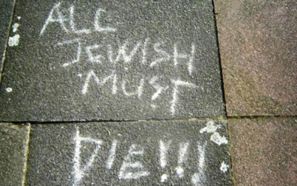 Graffiti on a piece of pavement in north London.