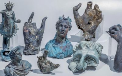 The Caesarea finds include well preserved bronze candles decorated with a likeness of the Roman Sun god Sol, a statue of the Moon goddess Luna, a candle in the form of an African slave's head and pieces of a vessel for carrying water.