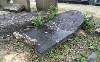 Officers said 14 gravestones were smashed and destroyed at the city's Blackley Jewish Cemetery.