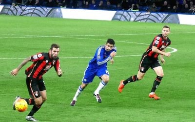 A.F.C. Bournemouth players in action against Chelsea in Blue