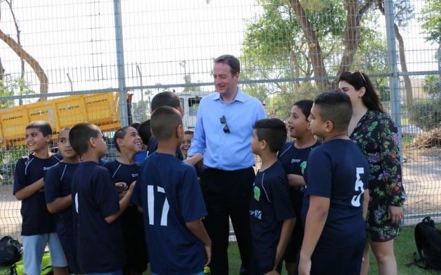 Ambassador David Quarrey with ar kids in Jaffa