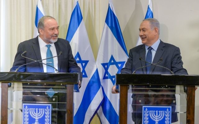 Lieberman and Netanyahu at a press conference after signing the coalition agreement (Photo credit: Amos Ben Gershom/GPO)