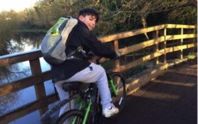 Joshku Gunusen on his bike, which helped him rise thousands