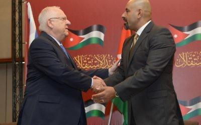President Rivlin (left) embracing the Jordanian ambassador to Israel   Photo credit  Mark Neyman/GPO