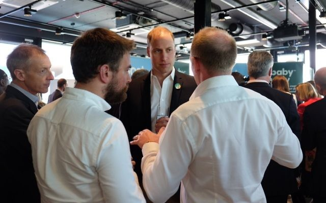 Jonny Benjamin (left) and Neil Layborn (right) speaking with Prince William