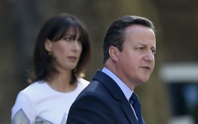 The morning after: David Cameron with his wife Samantha on the doorstep of 10 Downing Street on Friday.