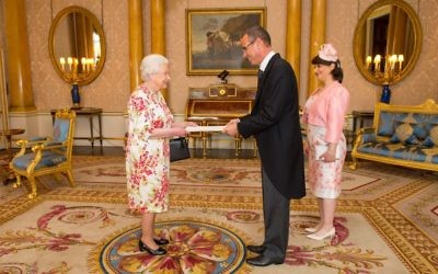 Ambassador of Israel Mark Regev and his wife Vered Regev meet Queen Elizabeth II during a private audience at Buckingham Palace (Photo credit: Dominic Lipinski/PA Wire)