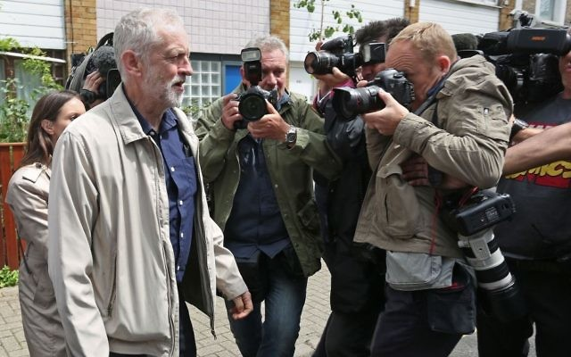 Labour leader Jeremy Corbyn leaves his house in London following a series of damaging resignations. (Photo credit: Isabel Infantes/PA Wire)