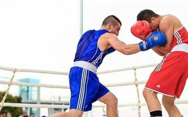 Israeli boxer Artiom Masliy (left) in action in a previous fight