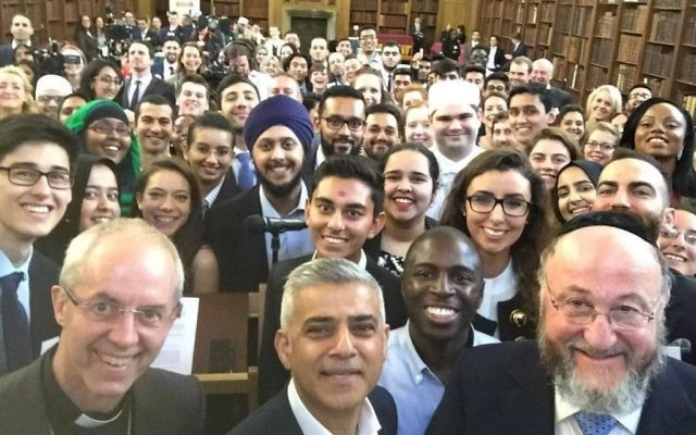 Chief Rabbi (front, right) with London Mayor Sadiq (centre)  Khan and the Archbishop of Canterbury Justin Welby (left), join people of all faiths at an interfaith Ramadan event in June 2016