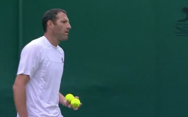 Jonathan Erlich is out of the men's doubles competition.