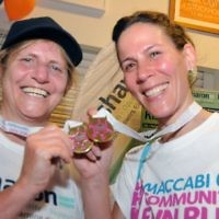 Kisharon chief executive Dr Bev Jacobson compares medals with Kisharon supporter Natalie Hoff.  Dr Jacobson did the 10k, 5k and 1k races. (photo: John Rifkin)