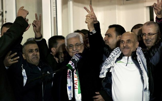 Palestinian President Mahmoud Abbas, receives a released prisoner during a welcome ceremony in the West Bank city of Ramallah (AP Photo/Nasser Nasser)