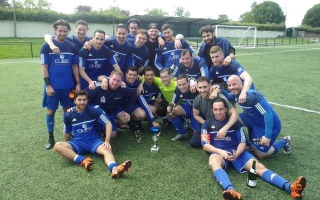 Redbridge B celebrate their cup win