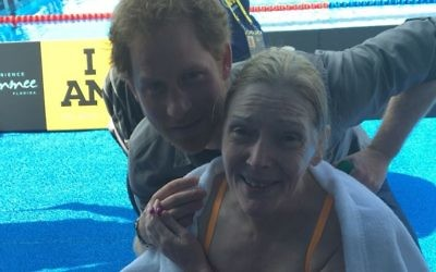 Sue with Prince Harry following her swim.