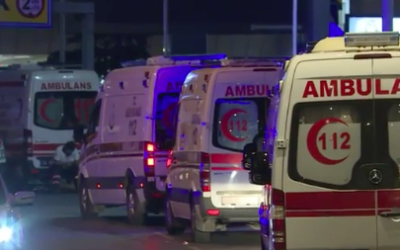 Ambulances outside the airport tending to the injured (Screenshot from youtube)