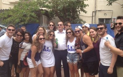 Young Olim celebrating with Mayor of Tel Aviv Ron Huldai