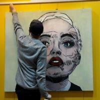Jordan with a large scale painting from his exhibition