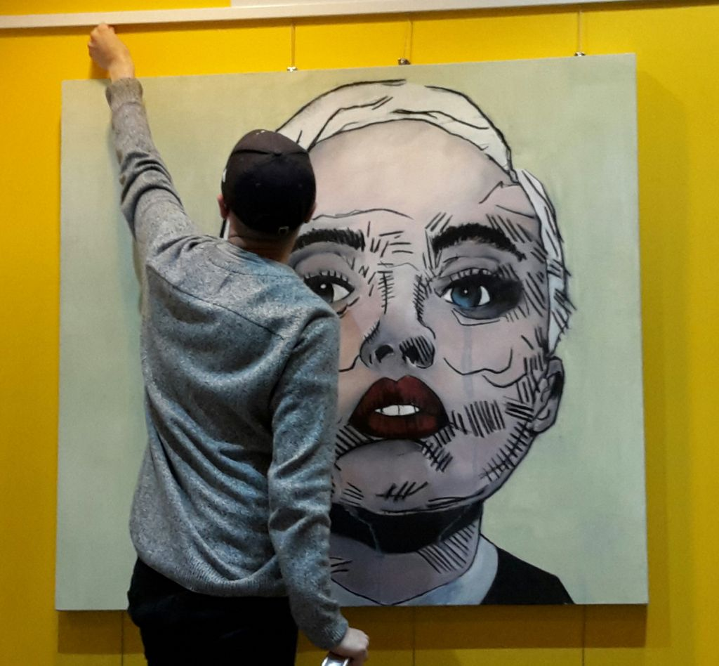 Jordan with his painting of singer Miley Cyrus.