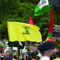 The striking Hezbollah flag during the Al-Quds rally in London, 2016 (Photo credit: Steve Winston)