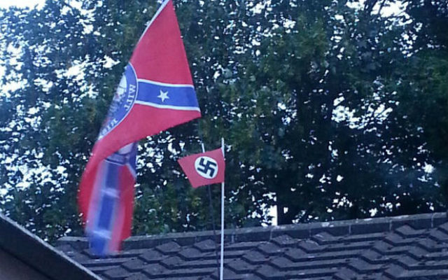 The Nazi flag mounted on the confederate flag, which has since been removed (Source: Phil Norris of Gloucestershire Live)