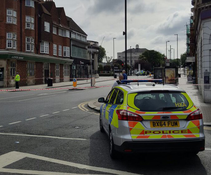 A police car stationed on Goders Green road after the area was cornered off