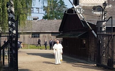Pope Francis entering Auschwitz I camp, located in Poland, through 'Arbeit macht frei' gate.