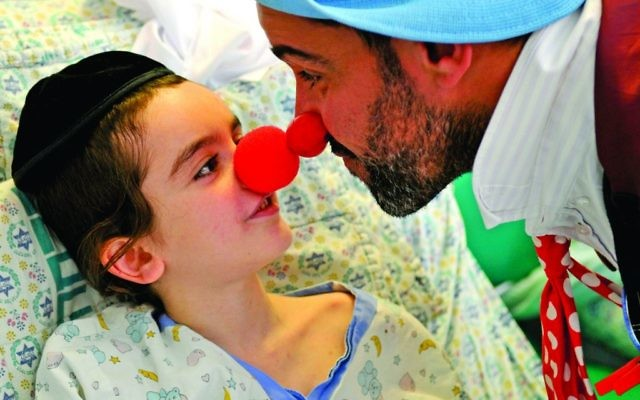 Red nose day takes on a whole new meaning for this youngster as he interacts with the medical clown (Photos: Avi Hayun & Yaffa Judah)