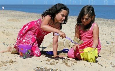 Kids enjoying the sunshine on the beach