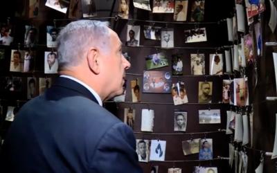 Benjamin Netanyahu viewing picture of child victims of the Rwandan genocide