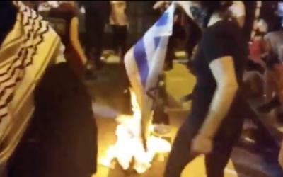 Burning Israeli flag
