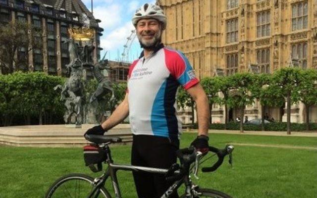 Fabian Hamilton MP outside parliament with his bike