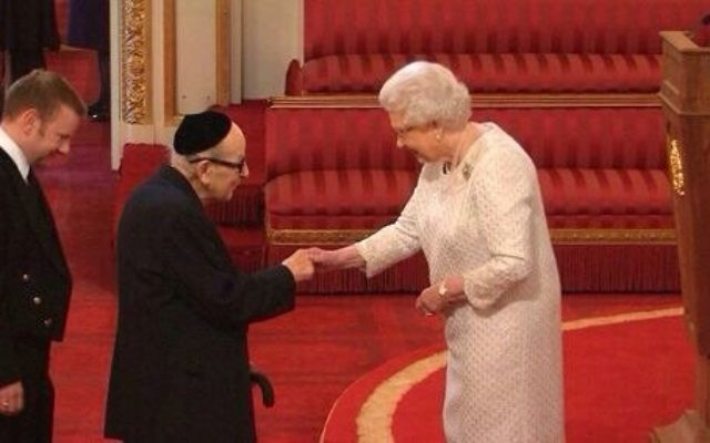 Reuben Turner receiving his MBE from the Queen