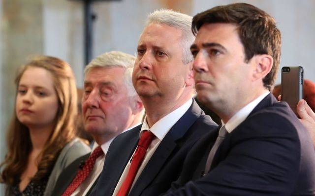 (From second left) Interim mayor Tony Lloyd and Ivan Lewis sit next to Andy Burnham, before he was announced as the Labour candidate who will fight to become the mayor of Greater Manchester. (Photo credit: Peter Byrne/PA Wire)