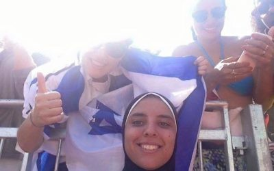 Egyptian volleyball player Doaa Elgabashy said she was unaware of the Israeli flag's presence when this photo was taken. (StandWithUs Facebook page)