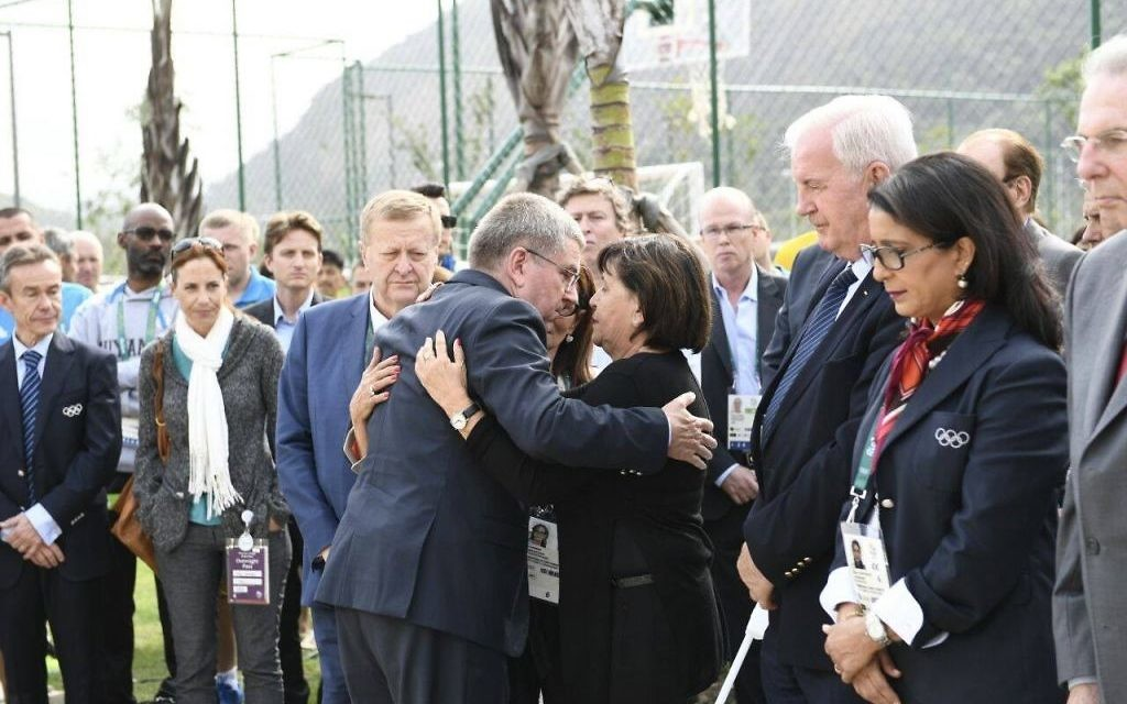 Ankie Spitzer embracing someone at the memorial to those who were murdered in 1972