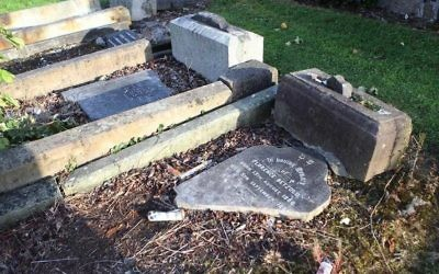 Headstones were smashed and knocked over Friday at a municipal cemetery in West Belfast, Northern Ireland.